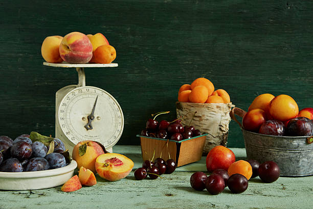 spread of various stone fruit, peaches, apricots, cherries, plums, nectarines, and prune plums