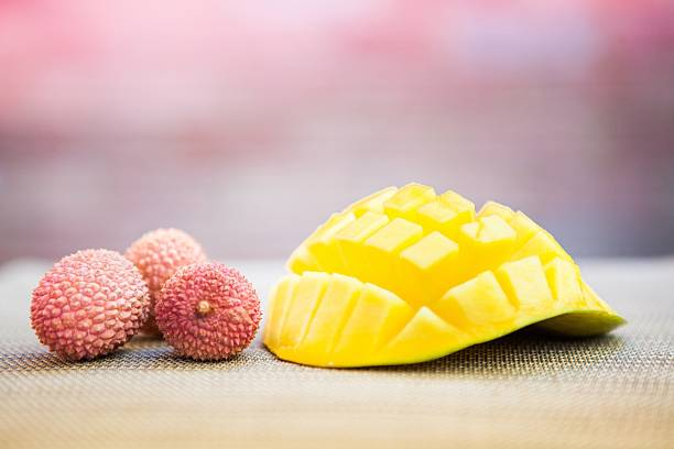 categories of fruits - lychee and mango