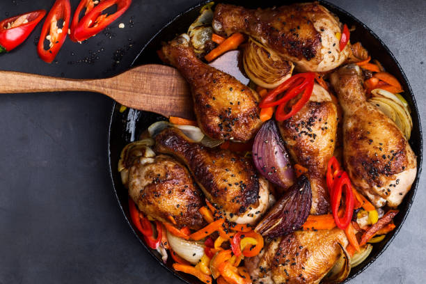 Spicy roasted chile miso  chicken drumsticks  with bell pepper and onion