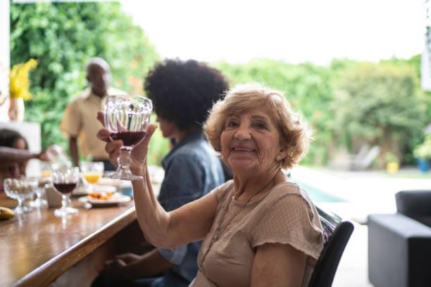 senior woman drinking grape juice